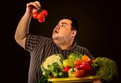 Diet fat man eating healthy food. Health breakfast with vegetables tomatoes for overweight person. M poster