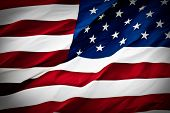 stock photo of american flags  - an american flag boldly flying in the wind - JPG