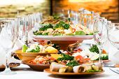stock photo of catering  - catering table set service with silverware and glass stemware at restaurant before party - JPG