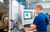 stock photo of machine  - mechanical technician operative of cnc milling cutting machine center at tool workshop - JPG