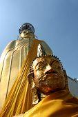 pic of hughes  - Hugh Gold Buddhist statue at a temple in Bangkok Thailand  - JPG