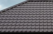 Brown Roof Tiles Or Shingles On House As Background Image. New Overlapping Brown Classic Style Roofi poster