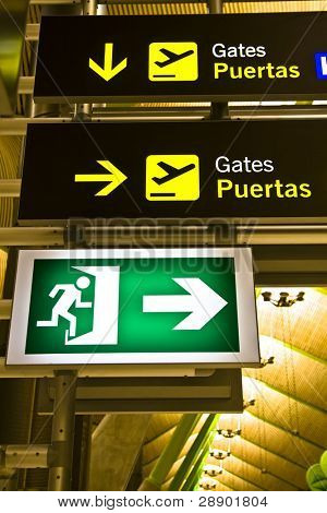 Gate and exit sign panels in airport, Madrid.