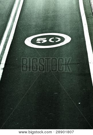 Speed limit printed on the asphalt