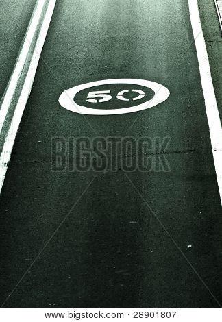 Speed limit printed on the asphalt