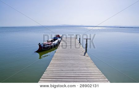 A boat tied in a footbridge, taken in the Albufera, Valencia.