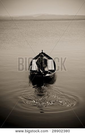 Fisherman going to work in dramatic background