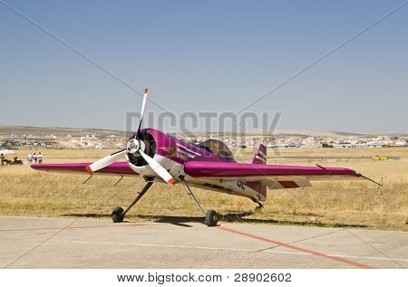 Stunt plane grounded under the Andalusian sun.