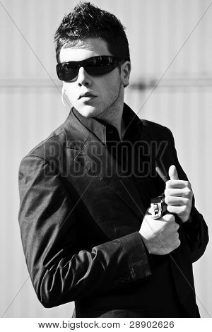 Alertness secret agent ready for action in black and white