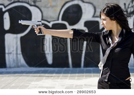 Mafia girl in urban graffiti background