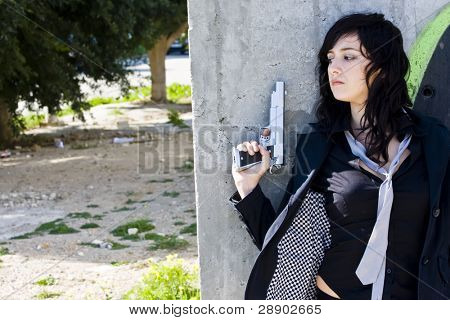 Hidden mafia woman with gun