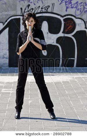 Mafia girl in urban graffiti background