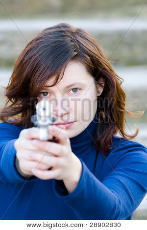 Red haired beauty with a gun in her hands