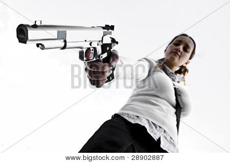 Young girl aiming with a gun isolated on white