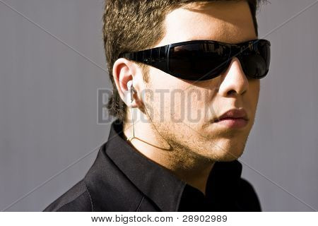 Young model performing security agent isolated on grey