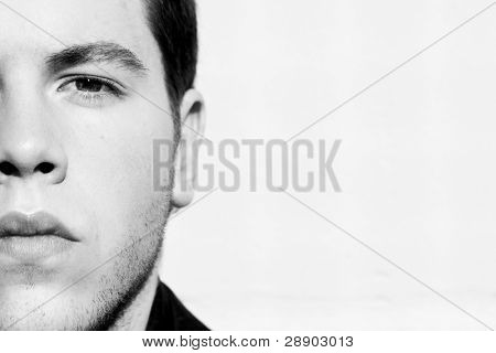 Unshaved handsome man portrait in black and white.