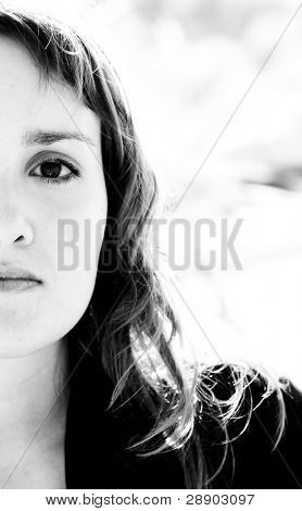 Portrait of beauty with awe reflection in her eye. Isolated on white.
