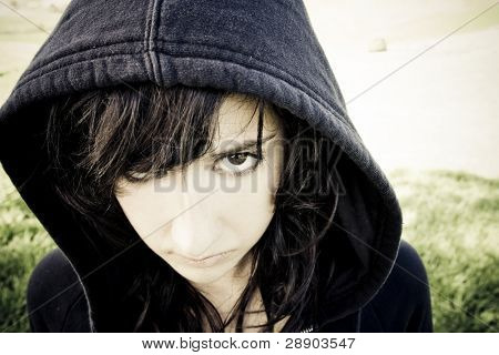 Scary young woman staring at camera.