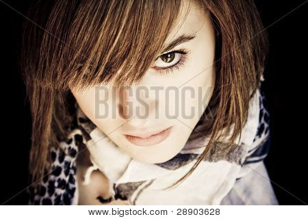 Serious young woman, obscure portrait