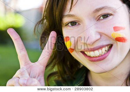 Spanish fan celebrating her team victory.