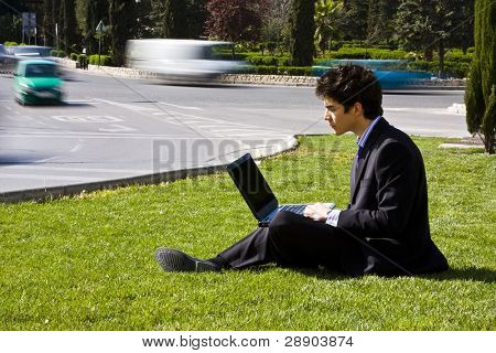 Outdoors working businessman, urban background