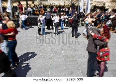 Couples dancing in tango street festival