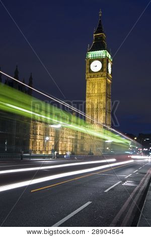 Nocturne scene with Big Ben behind light beams.