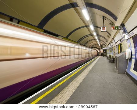 Blurred train arriving at Candem subway station, London.