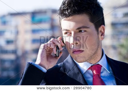 Businessman looking information at his phone