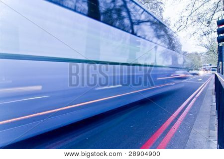 Blurred blue bus at the street.
