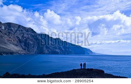 People in front of the Giants, cliffs in Tenerife Island, Spain.