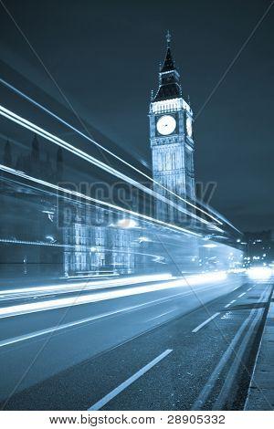 Nocturne scene with Big Ben behind light beams, blue toned.