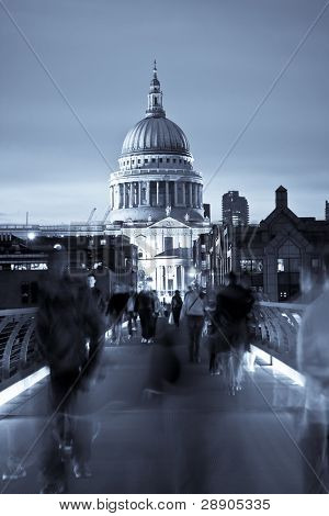 Blurred people on the Millennium bridge, London.