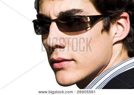 Very close portrait of businessman in sunglasses.