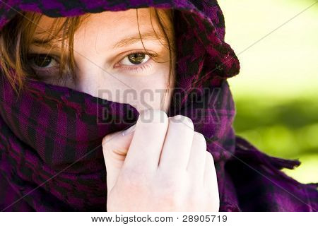 Staring woman portrait covered by veil