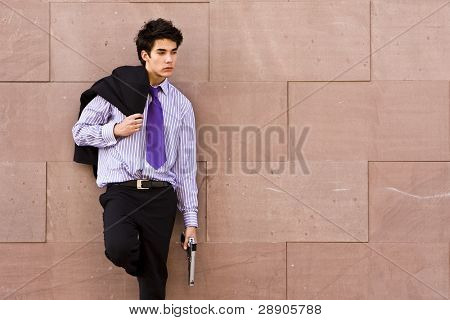 Armed agent over urban background