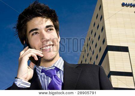 Businessman on phone over urban background