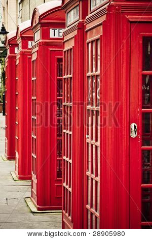Five red phone boxes, grunge toned