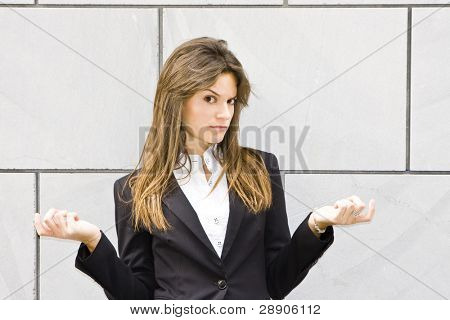 Doubtful businesswoman, isolated on white