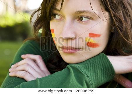 Sport Spanish fan with her colors in the face