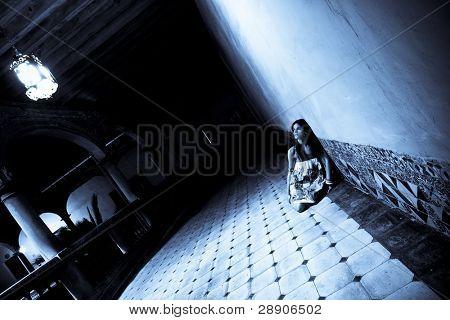 Terrified alone woman on dark corridor