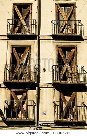 Sealed windows in old deteriorated facade.