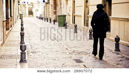 Young woman walking alone in the city