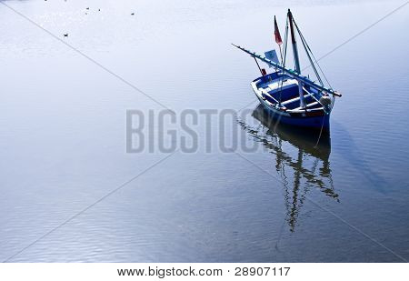 Portuguese fishing boat with beautiful reflection.