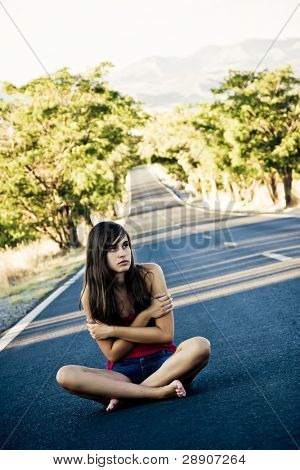 Lost beautiful girl in the middle of the road