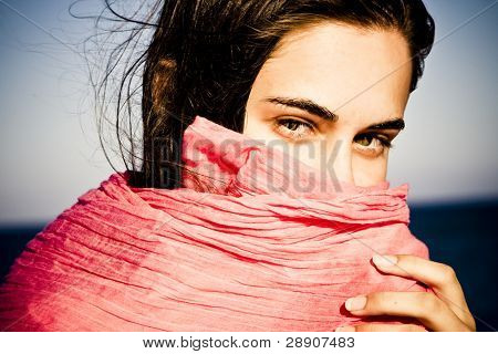 Shy beautiful green eyed woman behind veil.