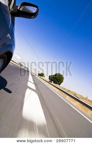 Blue car at high speed on the road