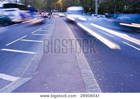 Blurred traffic seen from the middle of the road