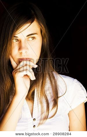 Young beautiful woman concerned about something
