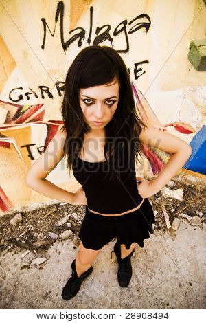 Goth girl posing in urban background.